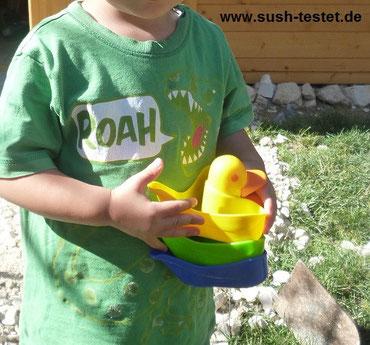 Kind mit Badeenten